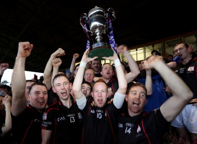 Mount Leinster Rangers Paul Coady lifts the cup.