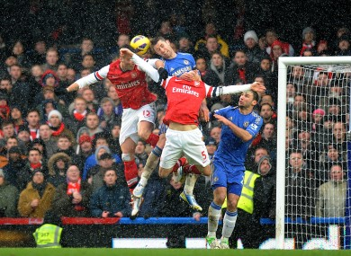 Chelsea's Gary Cahill and Arsenal's Olivier Giroud (left) battle for the ball.