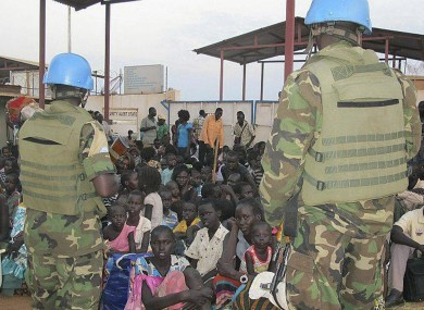 United Nations soldiers stand guard as civilians gather at the compound of the United Nations Mission in the Republic of South Sudan.