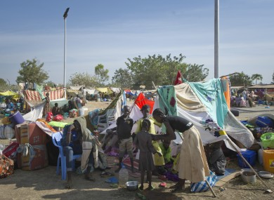 A displaced family sits with their belongings after seeking refuge at the compound of the UN Mission in Juba, South Sudan late last week.