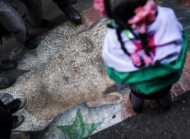 Syrians stomp on a portrait during a demonstration in the neighborhood of Bustan Al-Qasr, Aleppo (File photo)