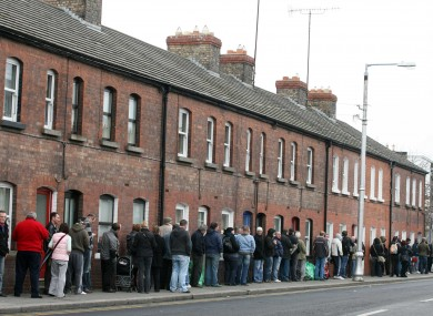 People queue down Cumberland Street, Dun Laoghaire to collect their social welfare payments back in 2009.