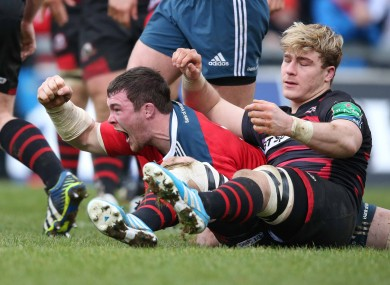 Munster captain Peter O'Mahony celebrates scoring the fourth try.