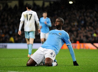 Yaya Toure celebrates scoring for Manchester City last night.