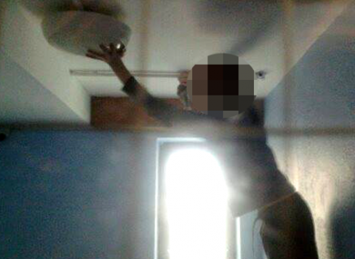 A child locked in a withdrawal room.  A member of staff took the photo after the child attempted to dismantle the light after being locked in the room for several hours.