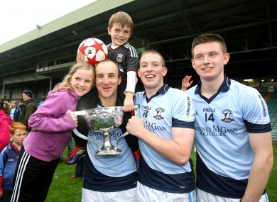 Damien Quigley with his children Emma and Colm, and teammates Shane Dowling and Kevin Downes after the 2011 Limerick county final.