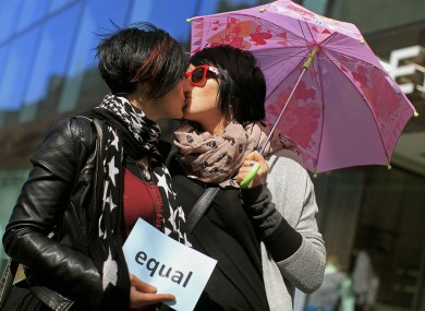 Maria Nugent (left) and Denise Morrisey kiss outside the Gaeity Theatre in Dublin in April 2012 as part of a demonstration for equal rights.