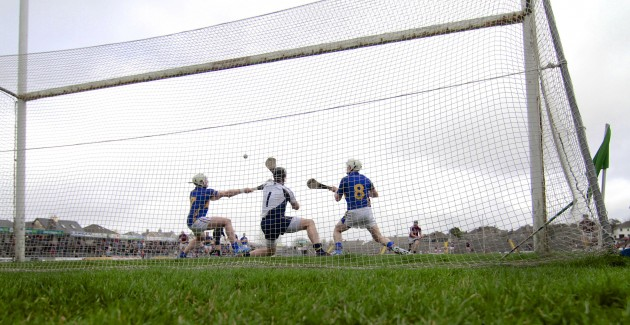Darren Gleeson, Padraic Maher and Brendan Maher fail to stop Connor Cooney's penalty