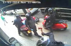 Men on mopeds use a sledge hammer, axe and gun in luxury jewellery shop heist in London