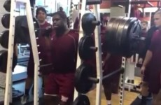 A college football lineman squats 810 pounds with perfect form